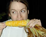 corn on the cob days - lady eating corn